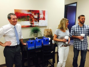 Anchor Brian Morrin mans the coffee while Samantha and Matt Stevens enjoy the conversation.